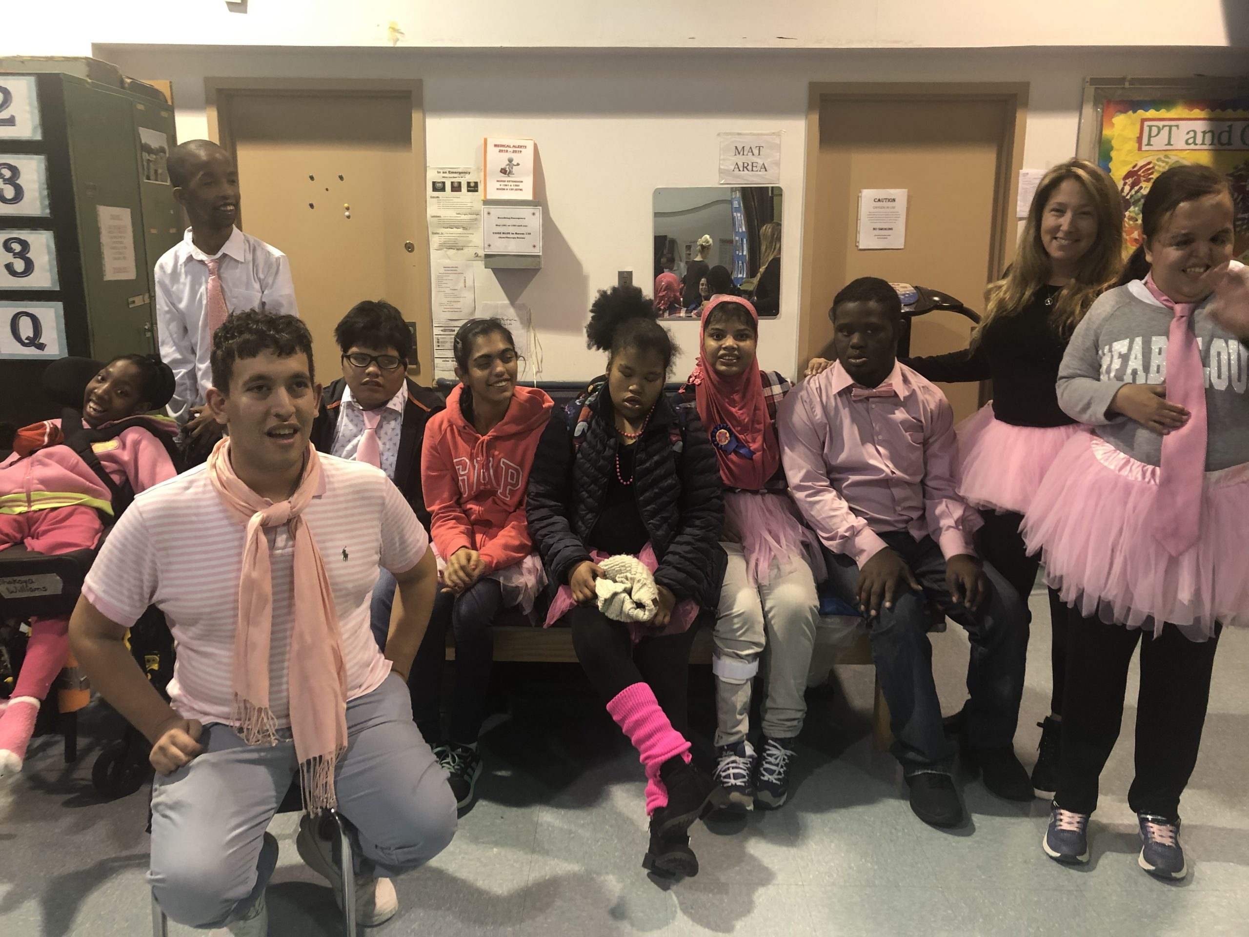 Students posing during the 875 breast cancer awarness week