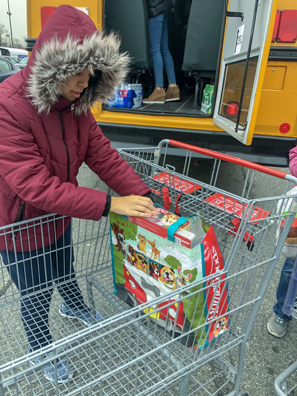 Ivana unloading a cart after shopping