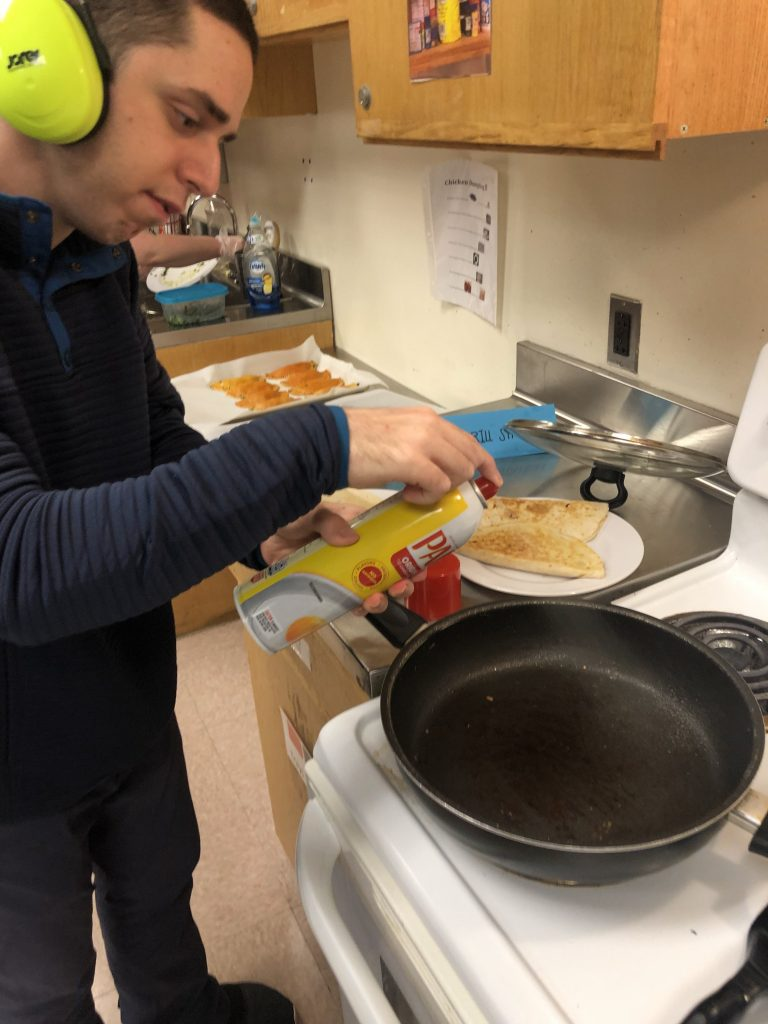Jacob cooking for the school Skill-it shop