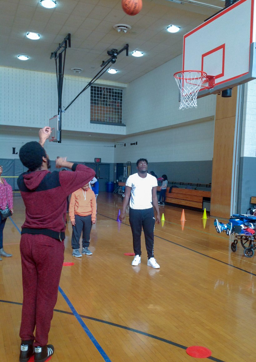 Jamal shooting hoops at the Heart Event.