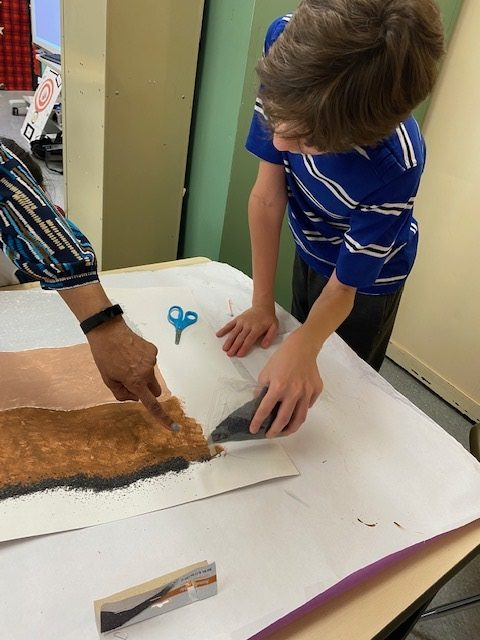 Student adding the layer of Earth where fossils can be found.