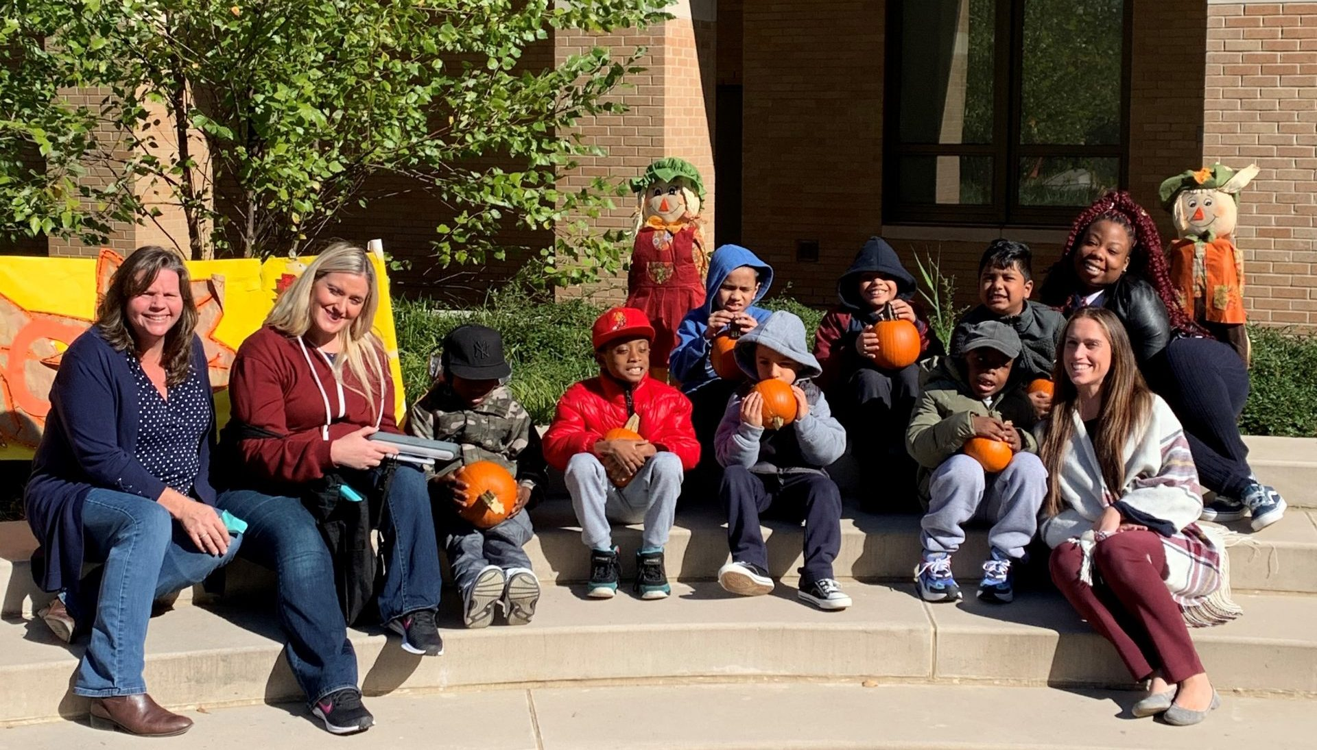 "X11 posed with the pumpkins they picked from the ""pumpkin patch"" during the Fall Festival."